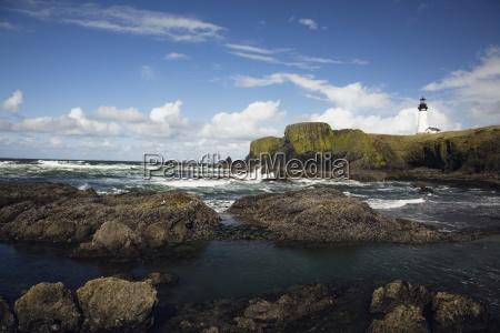lighthouse on rocky seashore oregon coastoregonusa