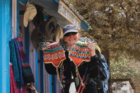 woman buying woolen hats from gift