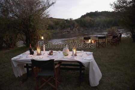 outdoor candlelit dinner at night maasai