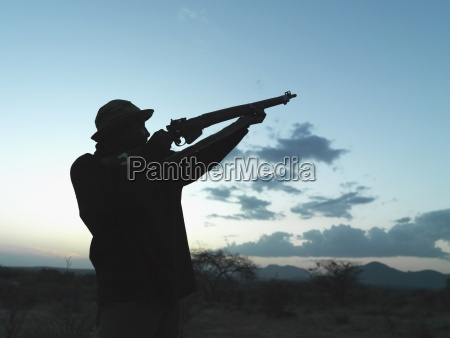 man holding a rifle to the
