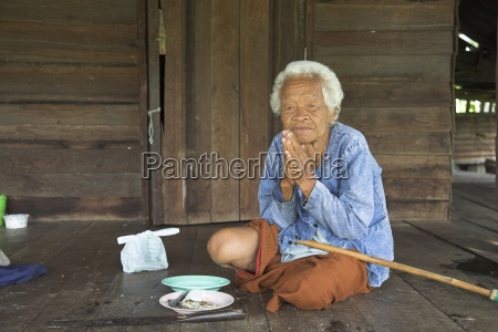 woman sitting on floor with meal