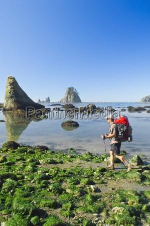 a man backpacking along the coast