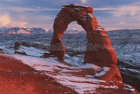 delicate arch at sunset in winter