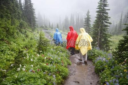 three hikers in a rain storm