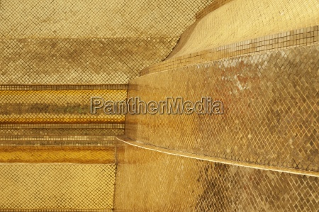 gilded tiles on stupa at wat