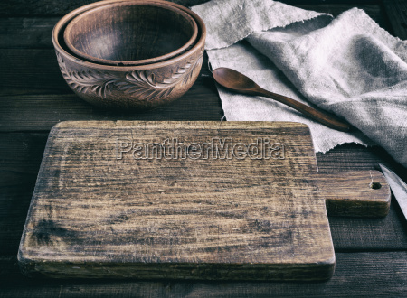 empty brown wooden cutting board with