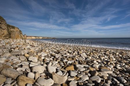 rocks on a beach along the