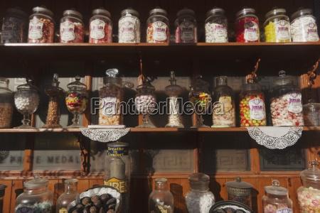 candies in jars displayed on a