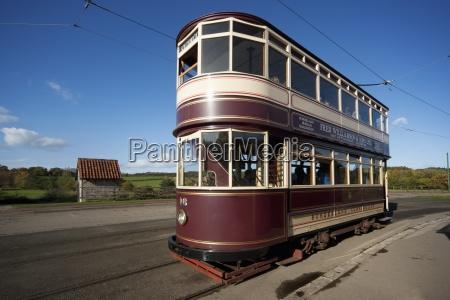 a double decker rail car traveling