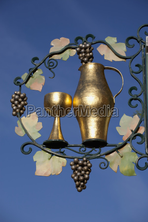 decorative gold sign of a goblet