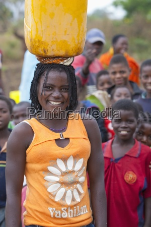 a young woman balances a water