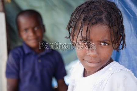 two children in their temporary shelter