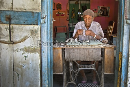 a haitian watch and clock repairman