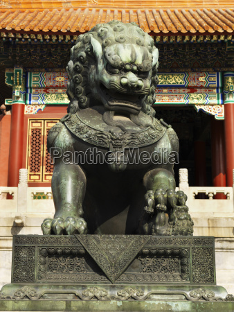 guardian lion statue in the forbidden