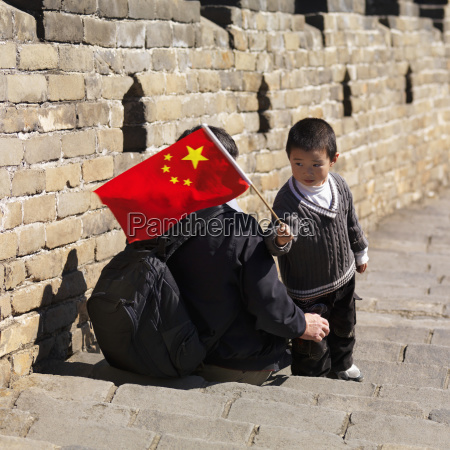 adult and child with chinese flag