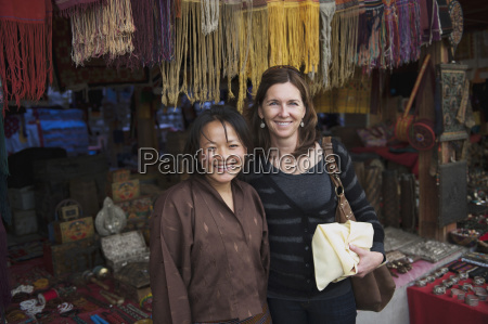 two woman at a market with