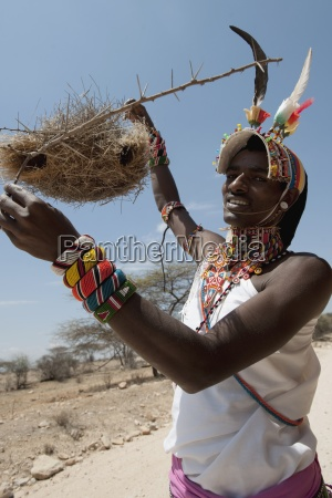 woman holding a nest of weaver