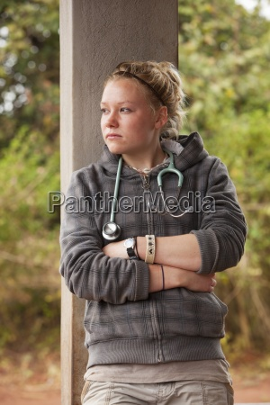 a young nurse deep in thought