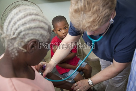 a nurse gives a check up