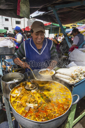 woman serving food at an eatery