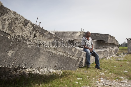 a man sits on the concrete