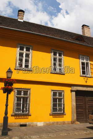 a painted yellow building in the
