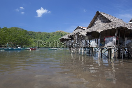 old stilt houses sit in the