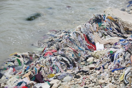 garbage on the beach along the