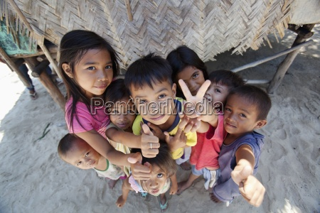 a group of children pose for