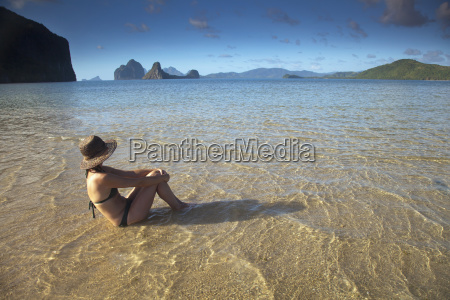 a woman tourist in a bikini