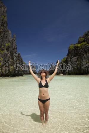a woman tourist wearing a sun