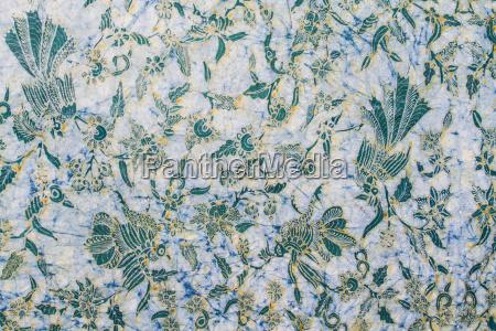batik cloth drying in the sun