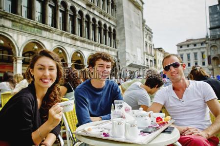 friends enjoying coffee on saint marks