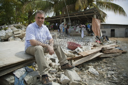 a man sits on the ruins