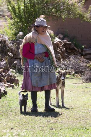 old tarabuco woman with her dog
