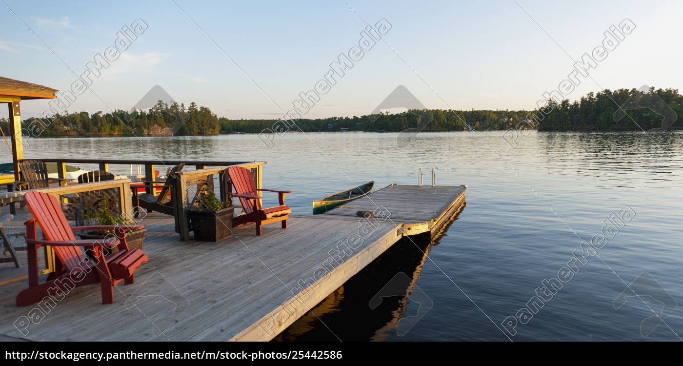 Rights-managed image 25442586 - Adirondack Chairs On A Wooden Chair Lake Of  The Woods