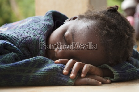 a child sleeping with her head