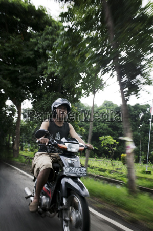 man on scooter bali indonesia