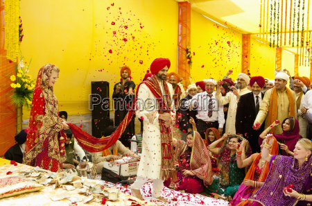 confetti being thrown on a bride
