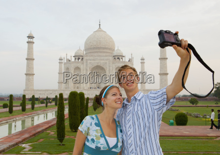 a young man and woman photograph
