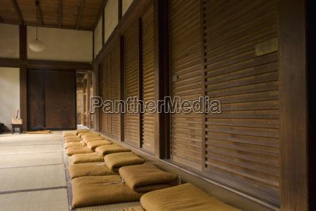 row of zen meditation cushions in