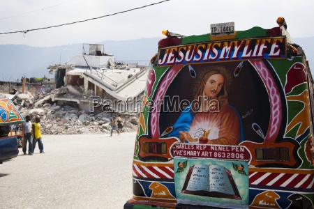 a painted vehicle saying jesus is