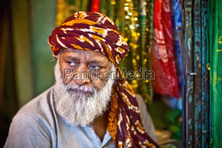 a man sells ornate cloth to