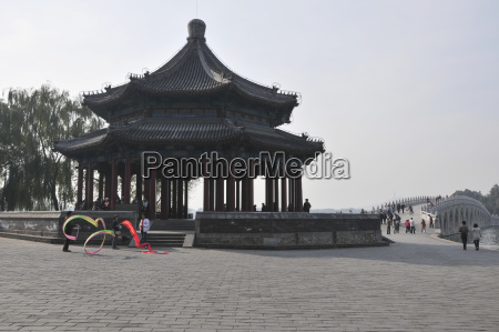 a traditional chinese structure with pedestrians