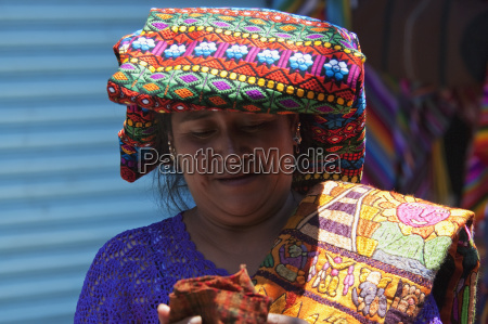 maya woman selling embroidered table cloths