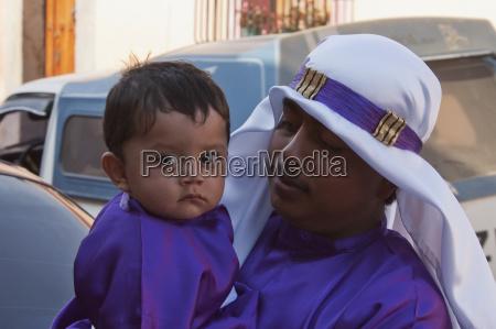 boy wearing purple as a sign