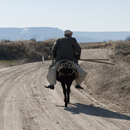 a man rides his horse down