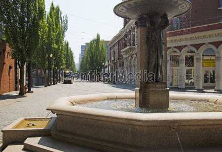 water fountain and streetcar in downtown