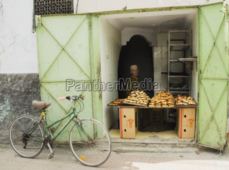 vendor selling bread with bicycle outside