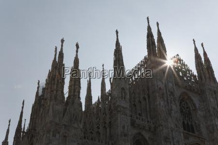 close up of cathedral spires backlit